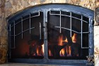 Slit and Drift Grill on Hand Forged Fireplace Doors