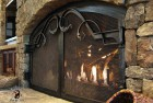 Forged Acanthus Pulls on Arched Fireplace Doors
