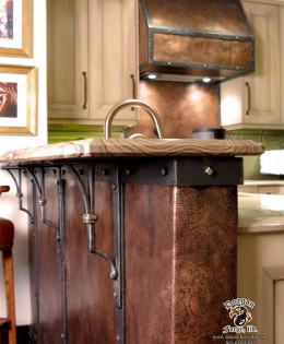 Copper kick plate with steel strapping and Copper stove hood