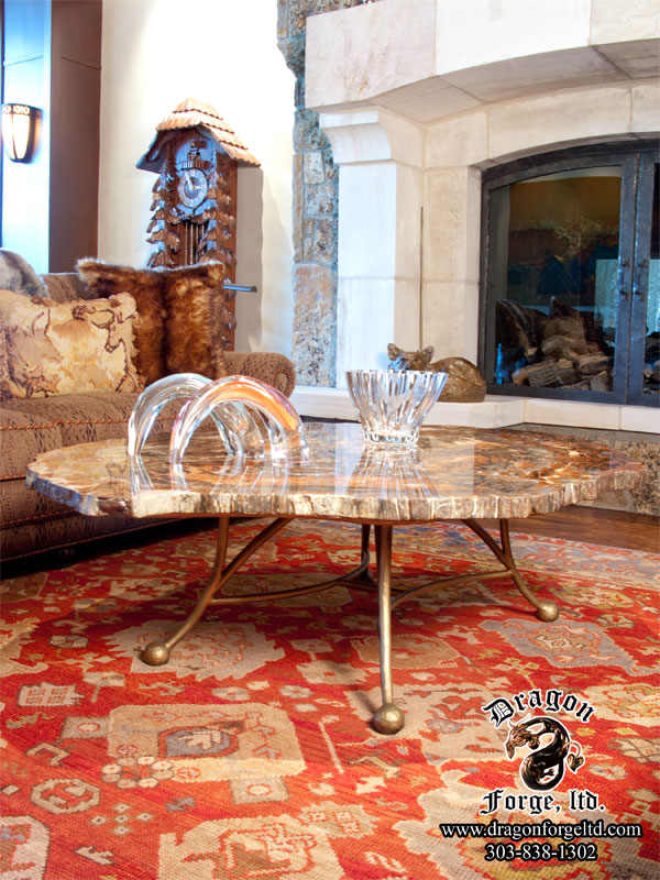 Forged-coffee-table-with-fossil-top