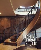 Rustic Iron Railing Descending Curved Staircase