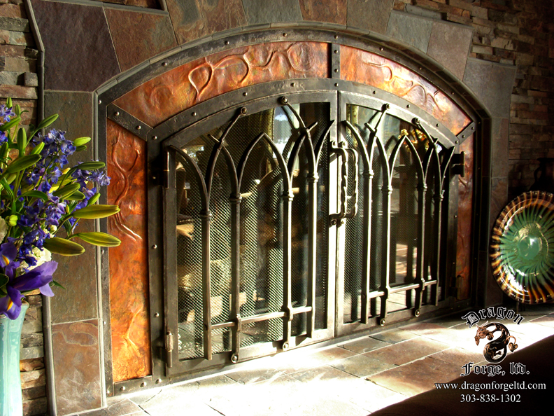 Hand Forged Custom Ornamental Iron Fireplace Doors with Copper Paneling