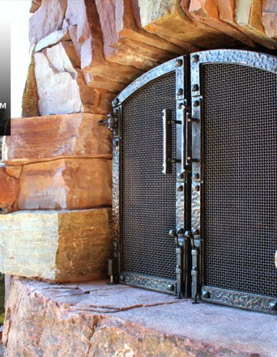GNL-modern-rustic-custom-fireplace-outside-bronze-doors