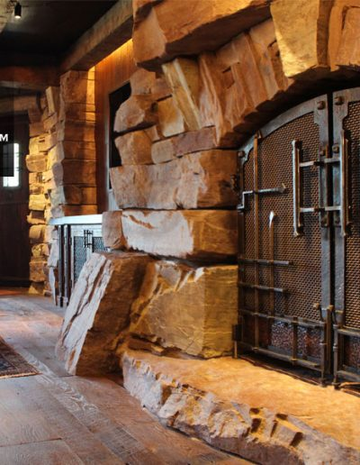 Great-Northern-Lodge-modern-rustic-blacksmith-fireplace-custom-doors