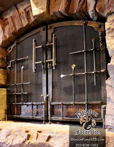Great-Northern-Lodge-modern-rustic-blacksmith-fireplace-doors